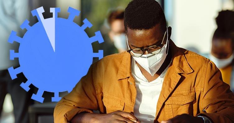 homme avec masque étudiant avec le symbole du coronavirus